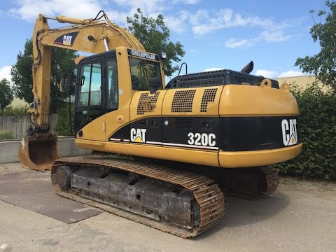 CAT 320C digger operating and demonstration