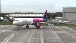 first a321 wizz air ha lxa arriving at gate london luton ltn