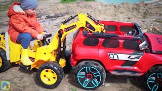 Red police toy car on power wheels stuck in the mud