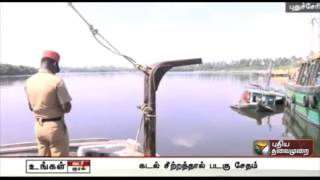 Fishing boat damaged due to rough seas sinks at the fishing harbour in Puducherry