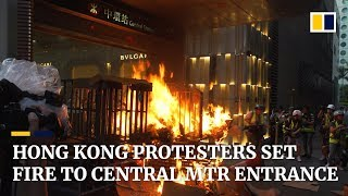 Hong Kong protesters set fire to Central MTR entrance