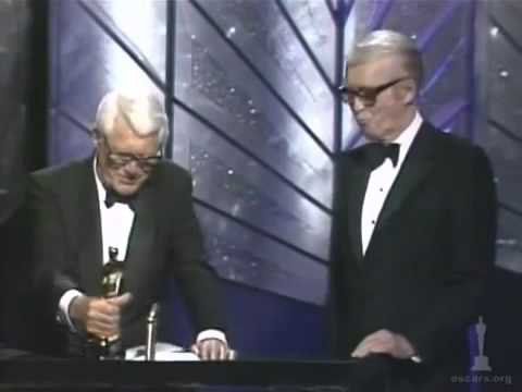 James Stewart receiving an Honorary Oscar from Cary Grant (1985)