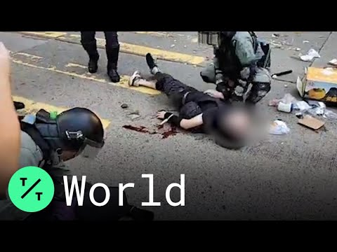 Hong Kong Police Officer Shoots Protester, Sets Off Day of M