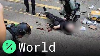 hong-kong-police-officer-shoots-protester-sets-day-mayhem