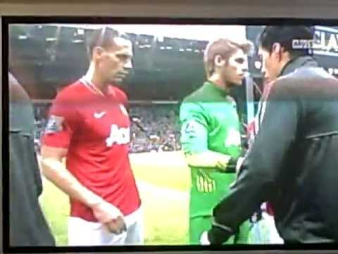 Suarez refuses to shake hands with Evra
