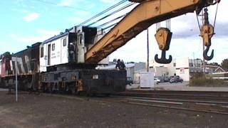 Railink gets the big hook out to re-rail a CP locomotive. North Bay, ONT.  9/16/1999