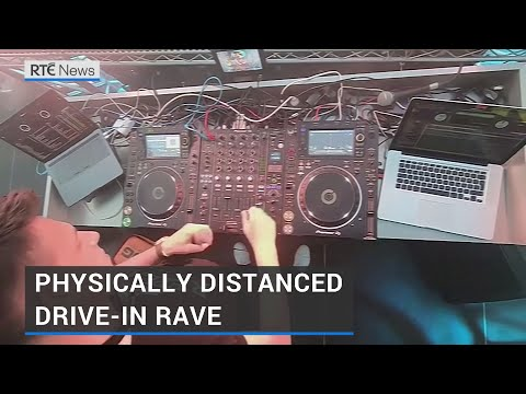 Germans attend physically distanced drive-in rave