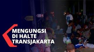 Banjir di Rawa Buaya Cengkareng, Warga Mengungsi ke Halte Transjakarta