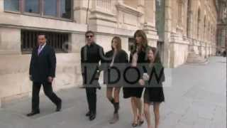 Stallone and family walking in the galleries of the Carrousel du Louvre in Paris