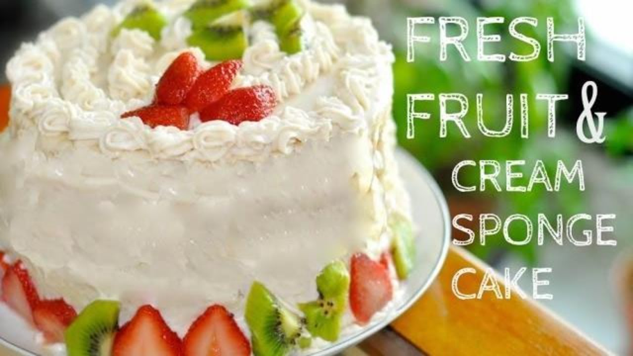 Layered Sponge Cake With Fruit And Whipped Cream Topping Filling
