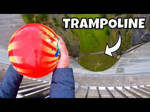 bowling-ball-vs.-trampoline-from-165m-dam!