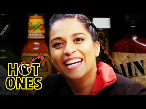 Lilly Singh Fears for Her Life While Eating Spicy Wings | Hot Ones video screenshot