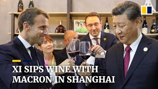 Xi and Macron sip wine together in Shanghai trade fair