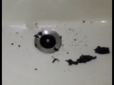 Cleaning clogged up wash basin pipe.