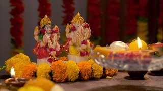 Woman performing Goddess Laxmi aarti on the occasion of Diwali