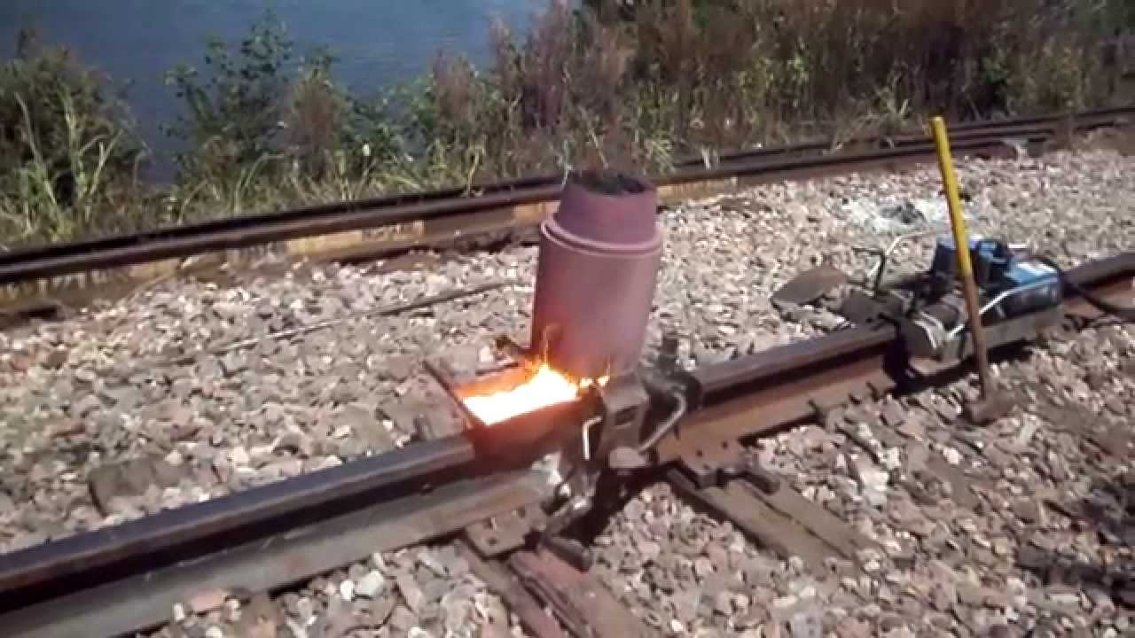 Railroad thermite welding near the Mississippi river - YouTube