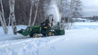 John Deere 1025r with Frontier SB1154 Snow blowing