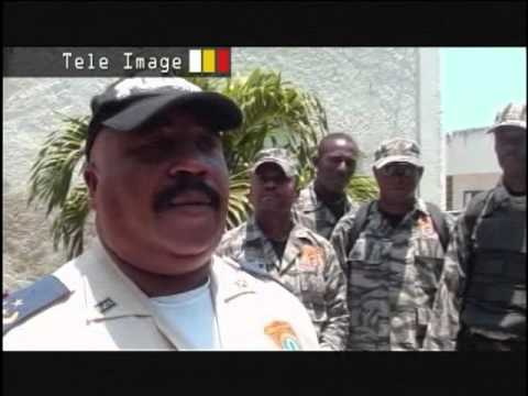 HAITI NEWS DESK  POLICE NATIONALE ARRESTATION FAUX POLICIER