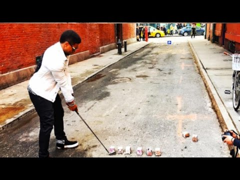 Usher Practicing His Golfing Skills Hitting Milk Cartons in SoHo New York