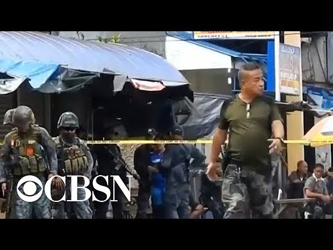 Twin church bombings kill at least 20 in the Philippines, dozens more injured