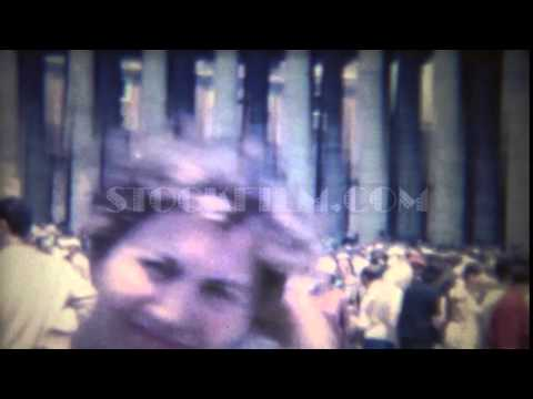 1963: Crowded Vatican City square people busy moving outdoor.    ROME, ITALY