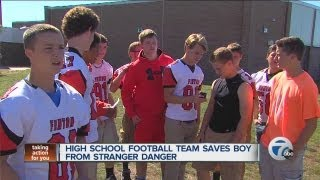 High school football team saves boy from stranger danger