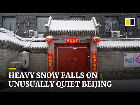Heavy snow falls on the unusually quiet Chinese capital Beijing