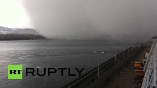 Russia: Watch this massive snow cloud hide a bridge in seconds