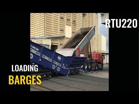 RTU220 Radial Truck Unloader loading Barges