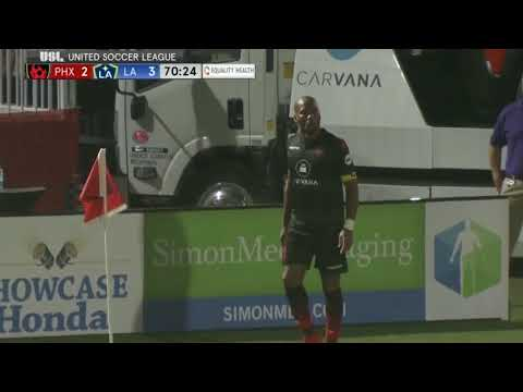 didier drogba gets assist off a corner after drinking from a kid's water bottle.