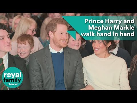 Prince Harry and Meghan Markle walk hand in hand