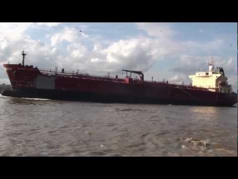 Ship on Mississippi River passing the St. Louis Cathedral, New Orleans