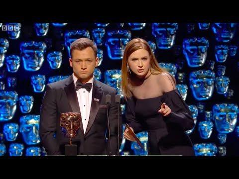 Karen Gillan and Taron Egerton presenting || BAFTAs 2018