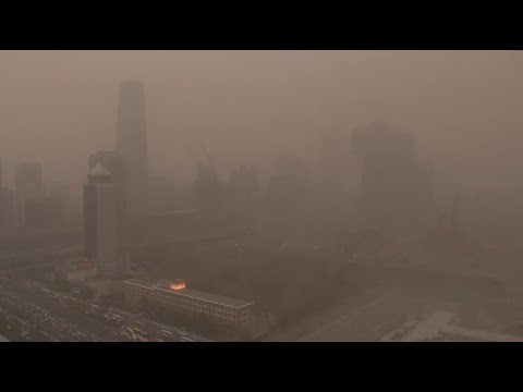 Sky Turns Yellow as Heavy Sandstorm Shrouds Beijing