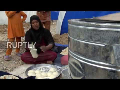 Iraq: Woman who fled embattled Mosul bakes bread in IDP camp to save money