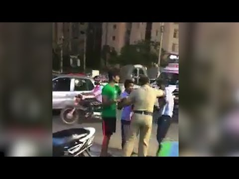 Chennai: Police beats 3 youth in the middle of the road for chasing, teasing girls