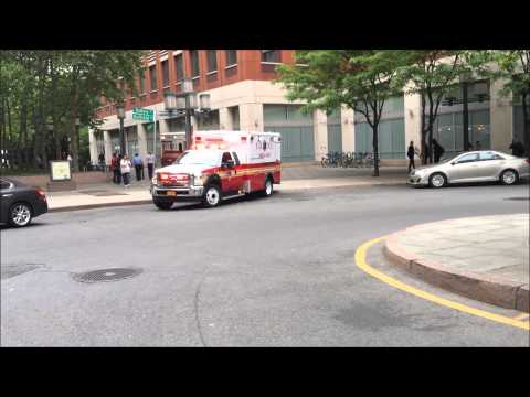 BRAND NEW FDNY RESCUE MEDICS AMBULANCE LEAVING FDNY HEADQUARTERS IN THE METRO TECH CENTER IN NYC.