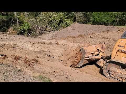Part 1, live action of building a livestock pond.