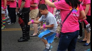 Kid does awesome dance at the Pride Parade