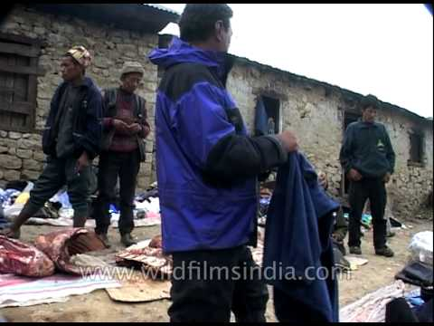Meat, jackets, blankets for sale at market in Nepal