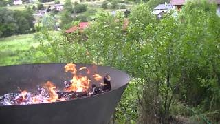 Kon-Tiki: Biochar making in open burn deep cone kiln