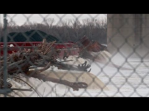 Crews working to recover barges at the bottom of the Ohio River