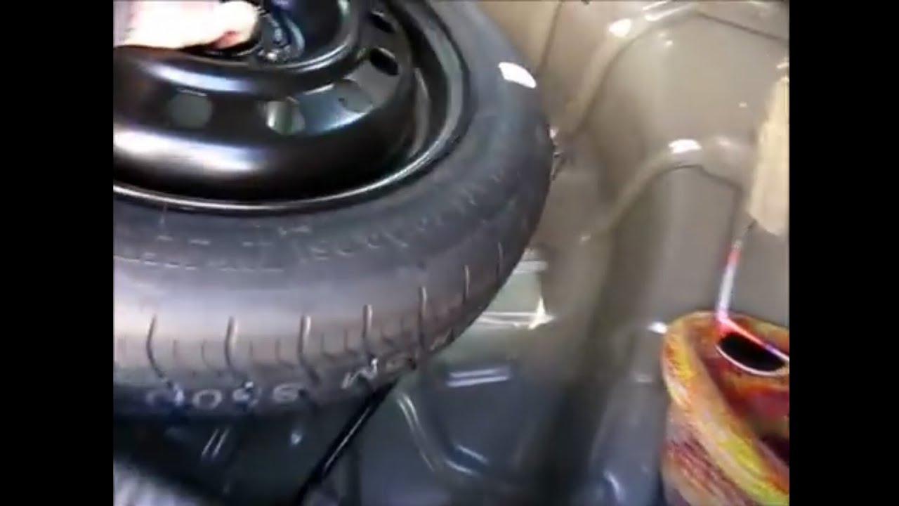 How To Stow The Spare Tire And Jack In A 2005 Ford Focus Youtube 2003 Mercury Grand Marquis Engine Diagram