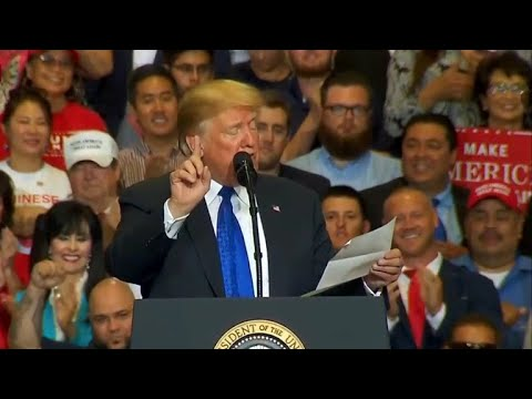 Trump reads lists of accomplishments from a piece of paper at rally