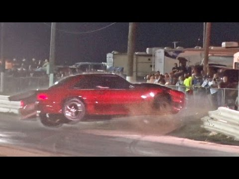 Mustang SMASHES Through Race Track Barrier!?
