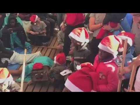 Migrant children receive Christmas gifts on charity boat