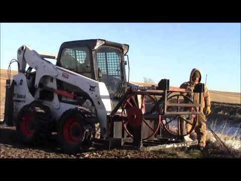Hooking up barbed wire fence to Dakota Wire Winder and Post Puller