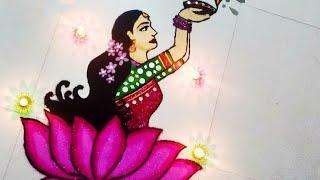 Diwali Rangoli: Lady with diya and lotus Rangoli