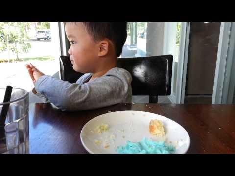 Isaac eating blue icing off a cupcake at Cafe Zimt, Surrey Hills