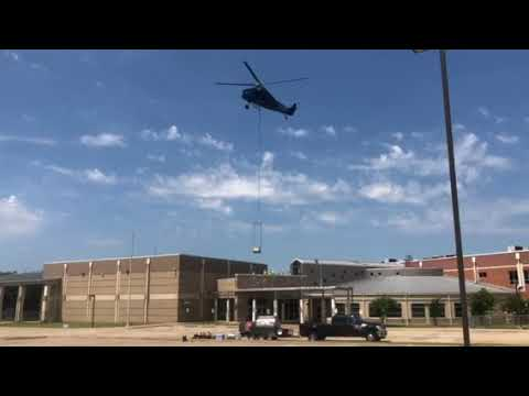 Helicopter works at Farmersville Intermediate School